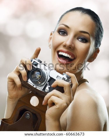 girl photographer is waiting for the shot - stock photo