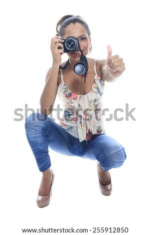 Girl-photographer takes snaps, isolated on white - stock photo
