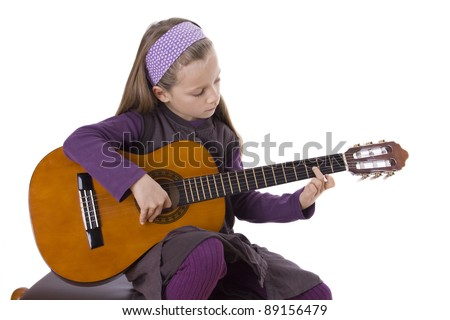 girl play a guitar/music/young learner
