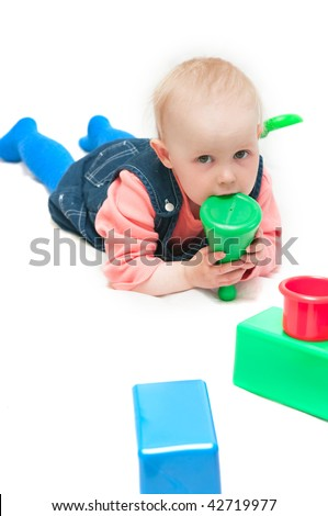 girl play cubes on a white background - stock photo