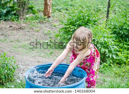 Girl play with water - stock photo
