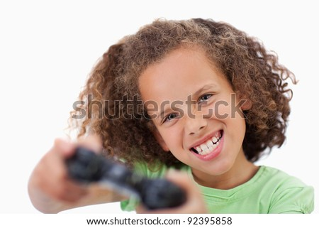Girl playing a video game against a white background - stock photo