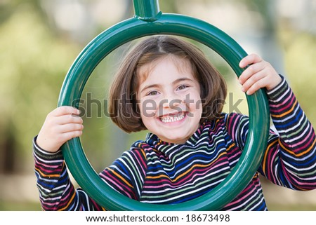 Girl Playing at the Playground - stock photo