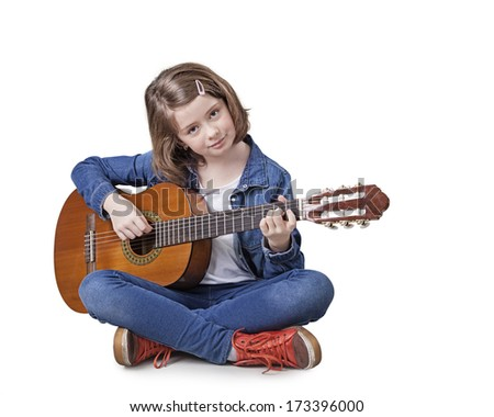Girl playing classical guitar isolated on a white background - stock photo