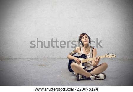 Girl playing guitar  - stock photo
