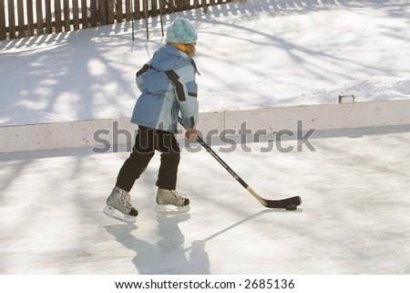 Girl playing hockey - stock photo