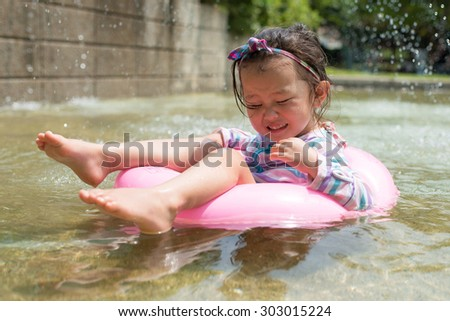 Girl playing in float
