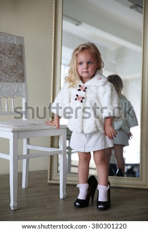 Girl playing in front of mirror