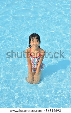 Girl playing in the pool
