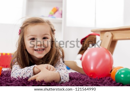Girl playing in the room - stock photo