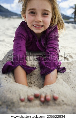 Girl Playing in the Sand - stock photo