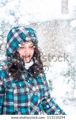 Girl playing in the snow - stock photo