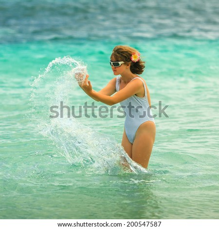 Girl playing in the water.