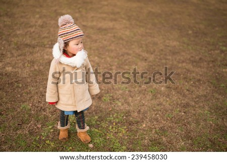 Girl playing in winter park - stock photo