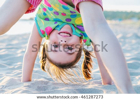 Girl playing on the beach.