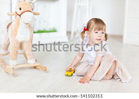 Girl playing on the warm floor