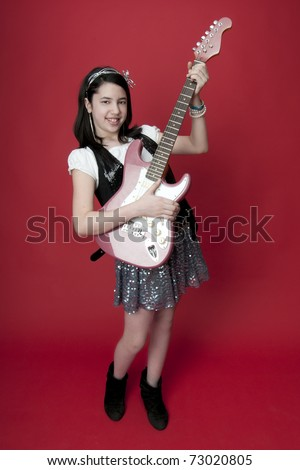 Girl playing pink electric guitar