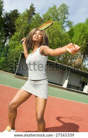 Girl playing tennis - stock photo