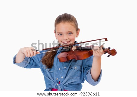 Girl playing the violin against a white background