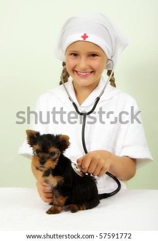 Girl playing veterinarian