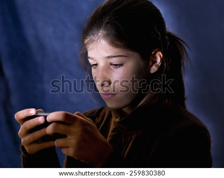 Girl playing video games - stock photo