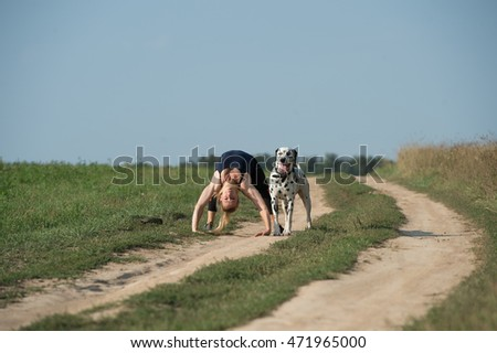 Girl playing with a dog Dalmatian