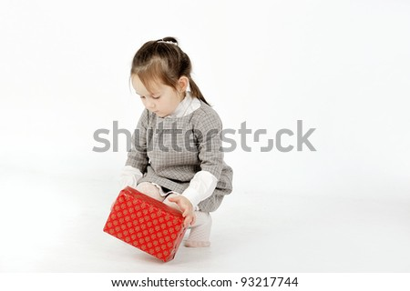 Girl playing with box