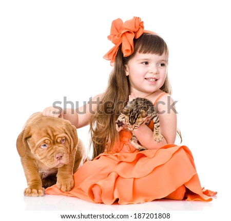girl playing with cat and dog. isolated on white background - stock photo
