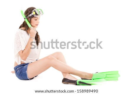 Girl playing with diving gear.  Isolated. - stock photo
