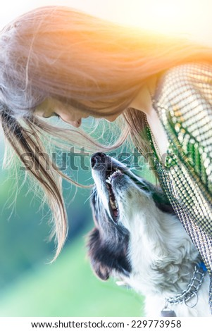 girl playing with dog - stock photo