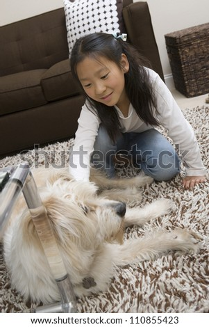 Girl Playing With Dog At Home