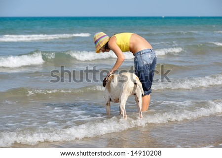 girl playing with her dog