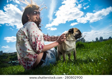Girl playing with her dog on the nature