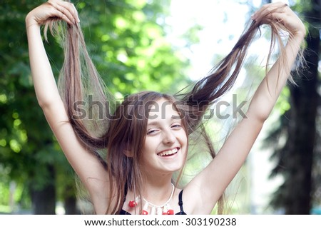 Girl playing with her hair - stock photo