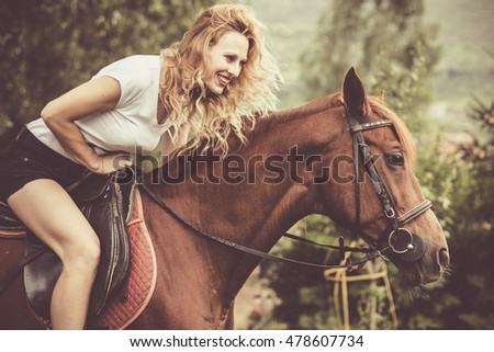 Girl playing with her horse on a beautiful day