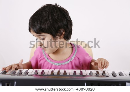 girl playing with keyboard
