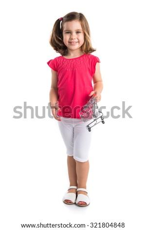 Girl playing with mini supermaeket cart  - stock photo