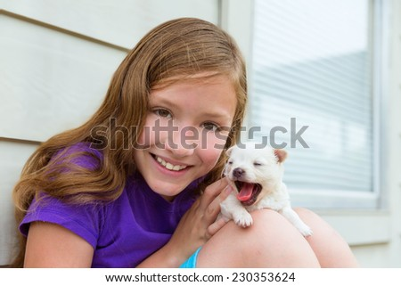 Girl playing with puppy chihuahua pet dog outdoor - stock photo