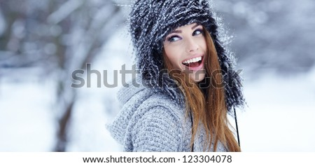 Girl playing with snow in park - stock photo