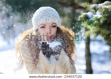 Girl playing with snow in park. - stock photo