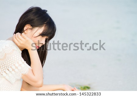 Girl plays at the sea