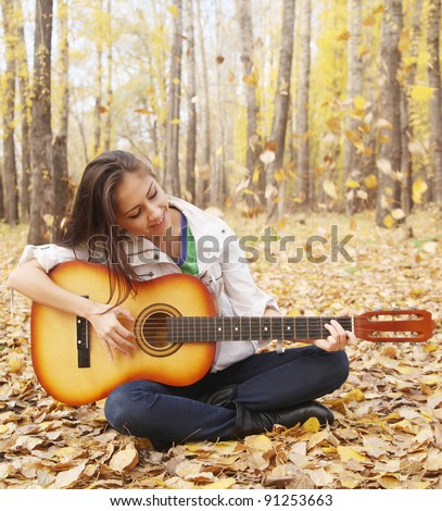 girl plays guitar autumn forest stock photo edit now 91253663
