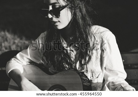 Girl Plays on Guitar and Sings. Black and White Style - stock photo