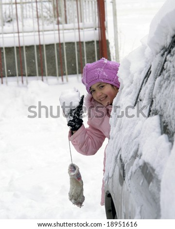 Girl plays snowball - stock photo
