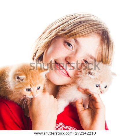 Girl plays with two kittens on her shoulders - stock photo