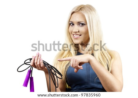 Girl points to a jump rope - stock photo