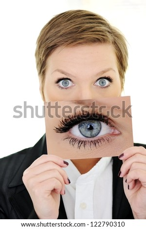 Girl portrait holding card with big eye concept