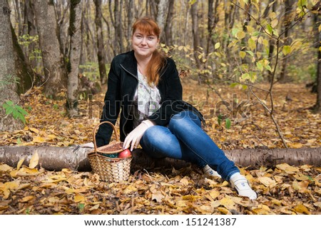 girl portrait photo in a mini skirt sitting on logs