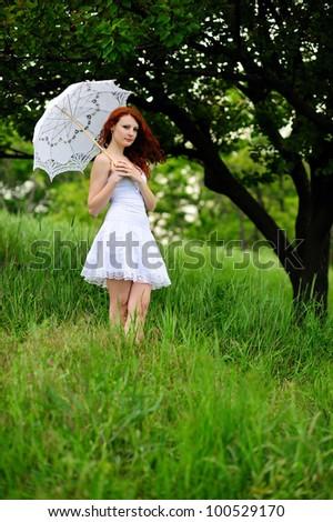 Girl portrait, walking with umbrella in park. Outdoor. - stock photo