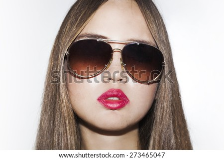 Girl portrait wearing sunglasses and red lipstick